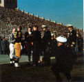 President Kennedy greets team captains on the field