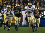 Midshipman fullback Adam Ballard (22) rushes for one of two touchdowns